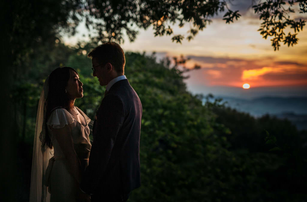 Couple portrait in the sunset in Italy