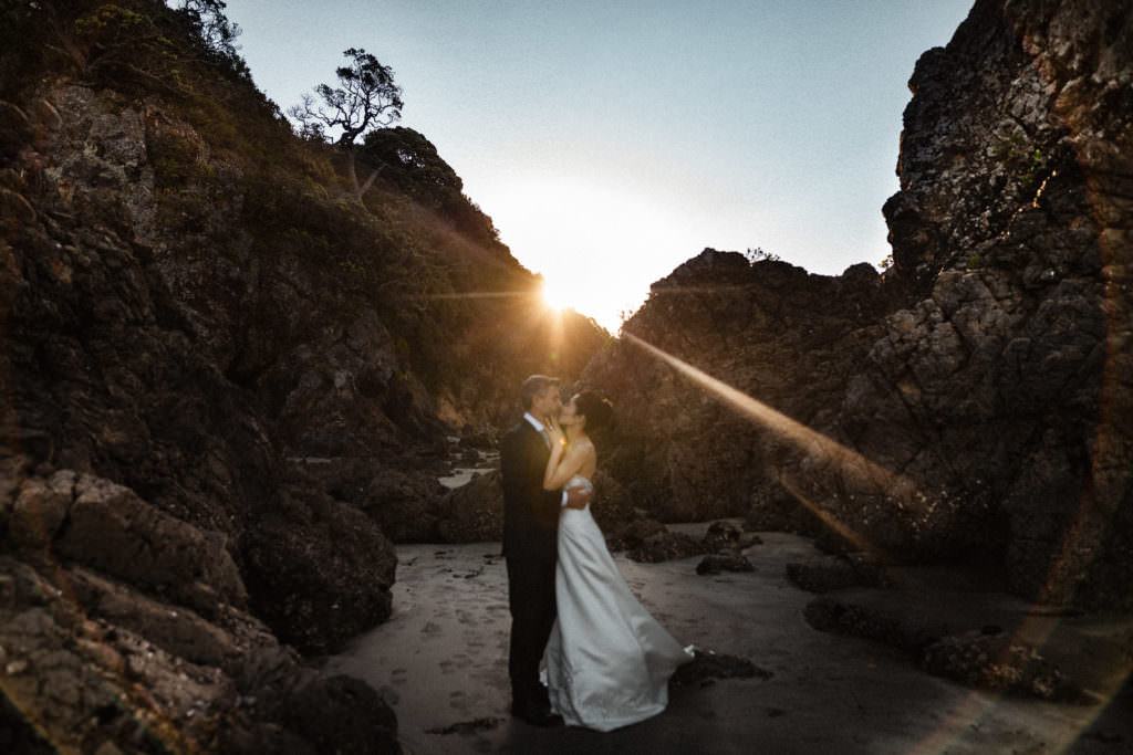 Couple sunset portrait by the sea in New Zealand