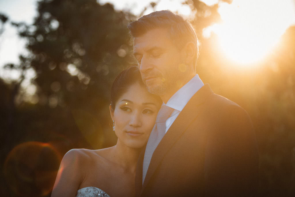 Couple portrait in the woods at the sunset in New Zealand